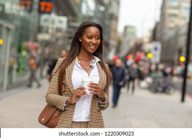 young business woman holding her coffee