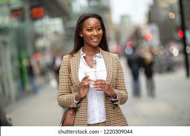 young business woman holding her coffee.