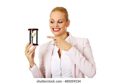 Young business woman holding hourglass.Time concept