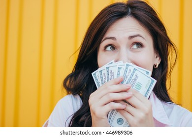 young business woman holding money . Happy woman with money