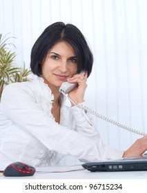 Young business woman holding the phone