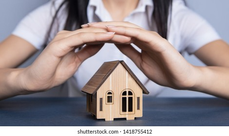 young business woman and house; insurance; business concept