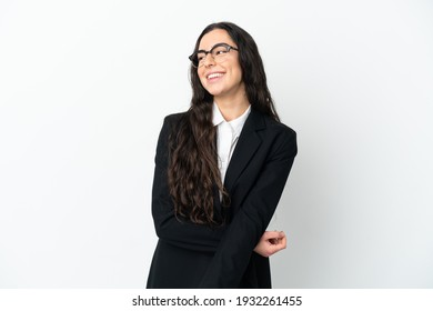 Young business woman isolated on white background looking to the side and smiling