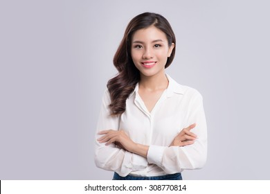 young business woman isolated on gray background
