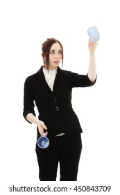 Young business woman juggling cup of coffee against white background