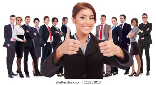 young business woman leader is very happy about the results , making the ok sign with her team behind, on white background