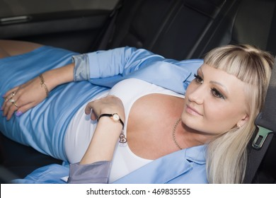 Young business woman with long hair sitting in seat of car