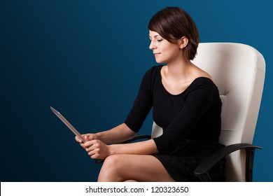 Young business woman looking at modern tablet