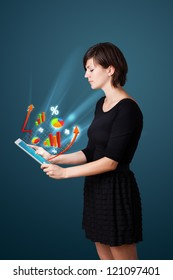 Young business woman looking at modern tablet with abstract lights and various diagrams