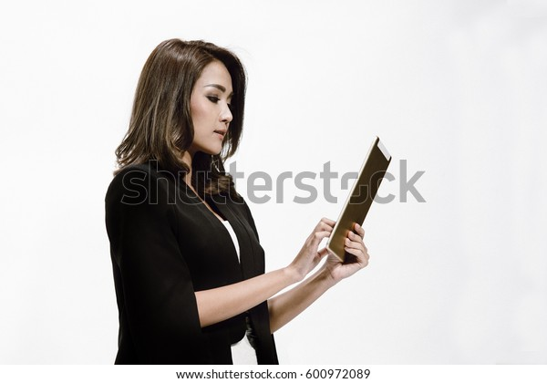 Young business woman looking on the tablet in her hand with white background and copy space.