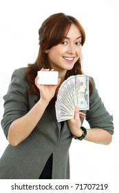 Young  business  woman  with money and the card on a white background