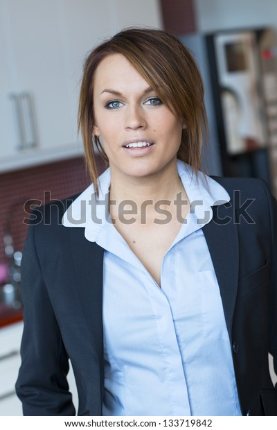 Young business woman in navy blue suit.
