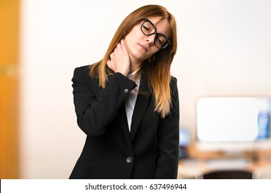 Young business woman with neck pain on unfocused background