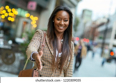 young business woman offering a handshake