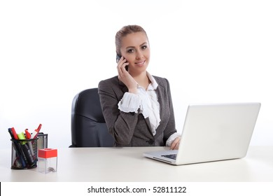 young business woman at office calling by telephone, working on laptop.