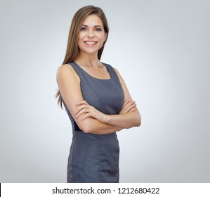 Young business woman in office dress standing with crossed arms. Isolated studio portrait.