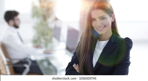 young business woman on the background of the office