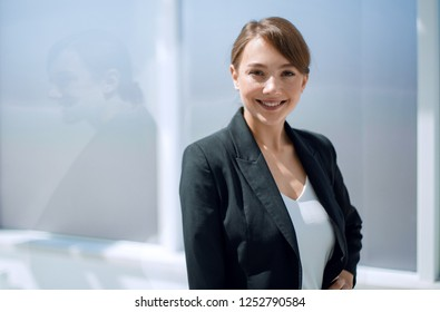 young business woman on office window background