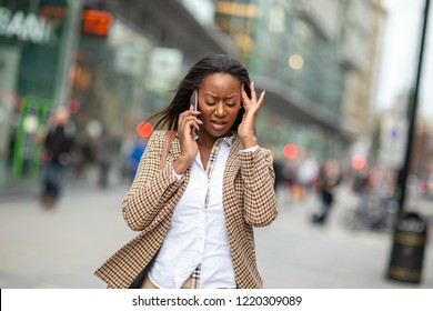 young business woman on the phone dealing with a difficult situation.