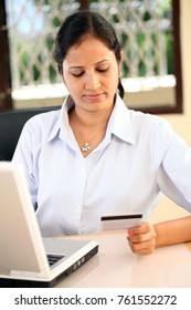 Young business woman online shopping