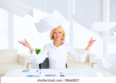 young business woman with papers flying up