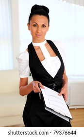 young business woman with papers in the office