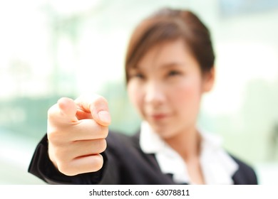 Young business woman pointing at you