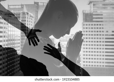 Young business woman praying to god asking for help.
