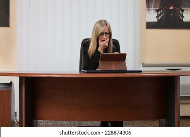 Young Business Woman With Problems And Stress In The Office