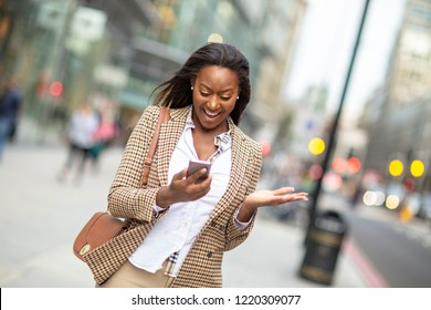 young business woman receiving a positive text message