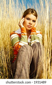 Young business woman relaxing on golden meadow