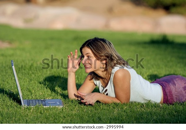 Young business woman relaxing, working on laptop