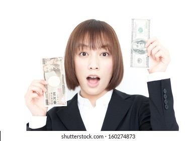 young business woman showing dollar and yen bill, isolated against white background