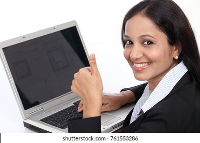 Young business woman showing thumbs up