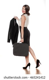 young business woman in a skirt with a bag with a jacket in her hand