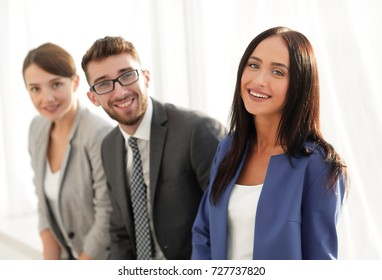 Young business woman smiling with her colleagues in the backgrou