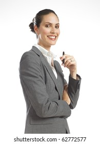 young business woman smiling and holding pen