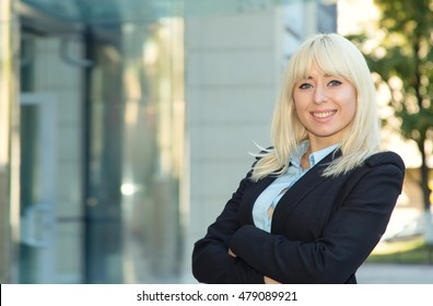 Young business woman standing with hands crossed in front of him.