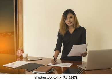 Young business woman standing work