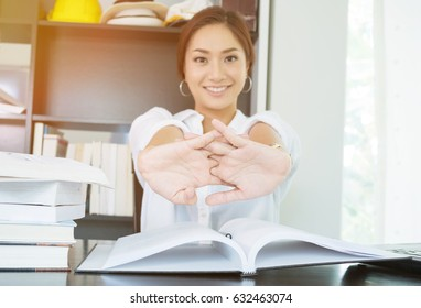 young business woman stretching arm relax after read and analysis data financial report in home office