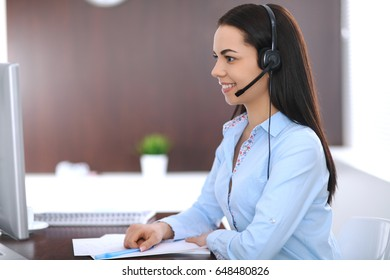 Young business woman or student girl with headset in office