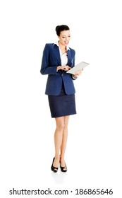 Young business woman with  tablet. Isolated on white.