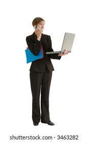 Young business woman in a tailored suit holding computer, cell phone, and folders. Image is isolated on a white background.