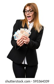 Young business woman taking a lot of money