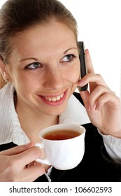 Young business woman talking on the phone and drinking tea