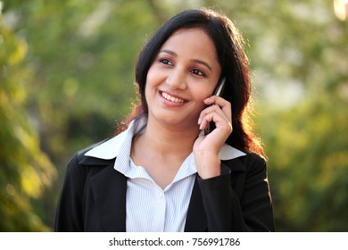 Young business woman talking on mobile