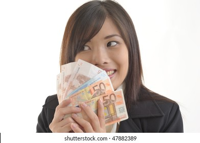 young business woman thinking what to do with money