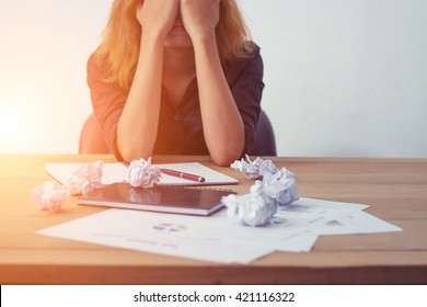 Young business woman tired and worry about work.