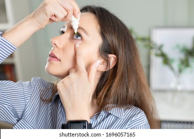Young business woman uses eye drops for eye treatment. Redness, Dry Eyes, Allergy and Eye Itching