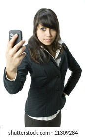 A young business woman using a PDA phone